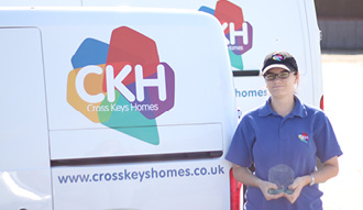 Apprentice Estate Ranger, Nicole, holds Award next to CKH van
