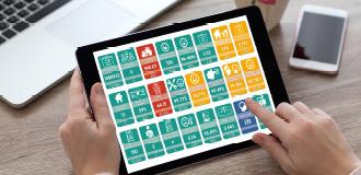 There is an Ipad displaying Cross Keys Homes performance menu cards