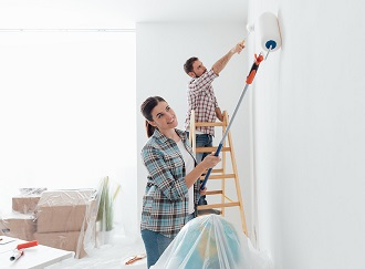 A couple are painting their walls white with rollers