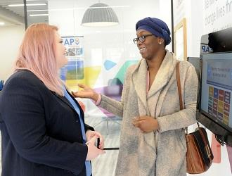 A customer talks to a Customer Service Adviser at Customer Central