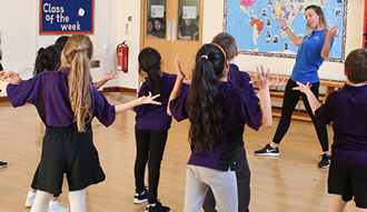 Image shows young people taking part in an exercise class