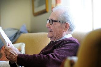 image-retirement resident reading magazine - card.jpg