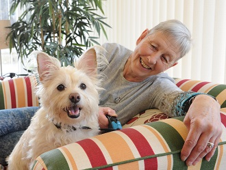 image-Retirement housing resident with dog - card.jpg